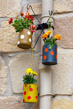 Hanging flowerpots made with cans.