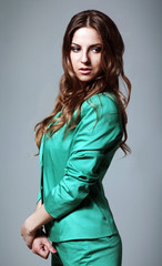 Beautiful woman in modern bright suit