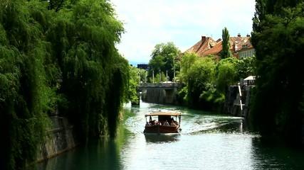 Small boat on the river. Ljubljana, capitol of Slovenia, Europe.