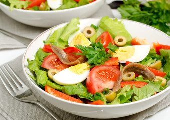Salad with tomatoes, olives, eggs and anchovies