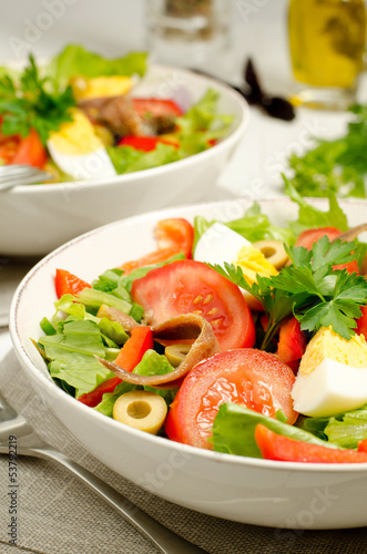 Salad Nicoise with tomatoes, beans, tuna, eggs and anchovies