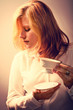young woman with a cup of coffee or tea - retouching Vintage