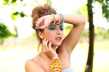 Beautiful woman with artistic makeup
