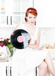 Beautiful woman with vinyl record