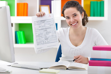 Female student showing perfect grade A plus.