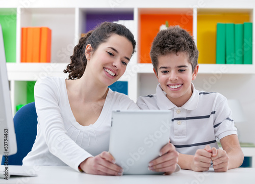 Smiling children with digital tablet