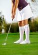 Golfer swing golf ball on the grass