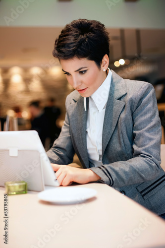 Young business woman with tablet
