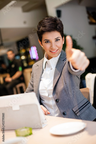 success businesswoman in cafe