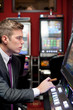 man concentrate on slot machine
