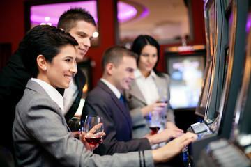 people gambling on slot machines