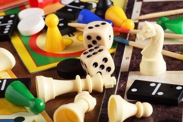 Board games, pawns, chessmen, dominoes and dices
