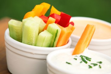 Vegetable sticks and dips in bowls