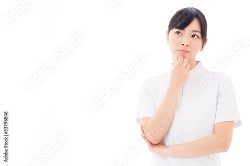 attractive asian nurse thinking on white background