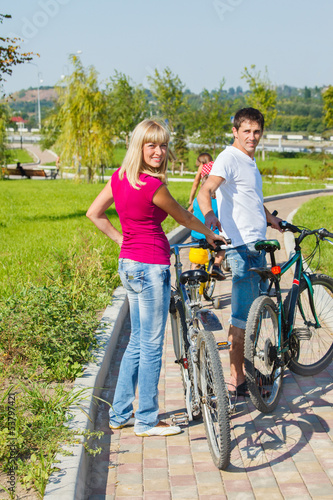 Woman and man with bicycles