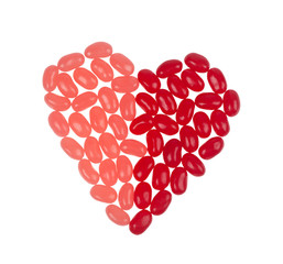 Jelly beans forming a heart shape isolated on white