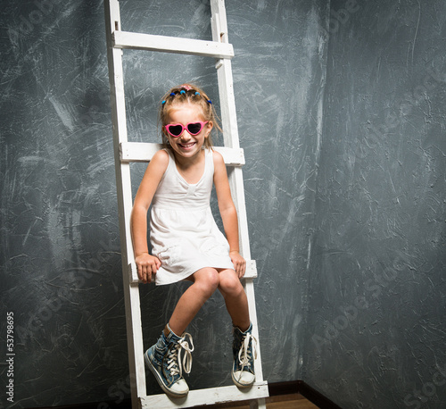 little girl on stairs