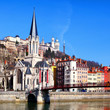 Lyon cityscape from Saone river with footbridge
