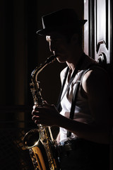Music in his soul. Black and white shot of men playing saxophone