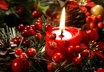 Red candle and christmas decorations