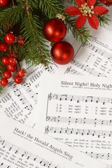 Sheets of Christmas carols. Focus on decorations