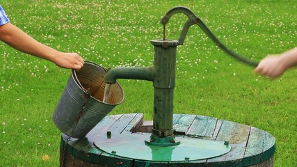 Man powered water pump at the well