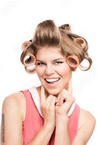 Portrait of happy blond woman with hair curlers, isolated