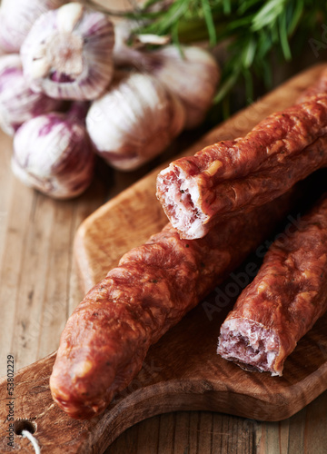 Dried sausage on wooden chopping board (polish cuisine)