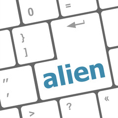 alien on computer keyboard key enter button