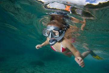 Beautiful healthy girl swims in the sea