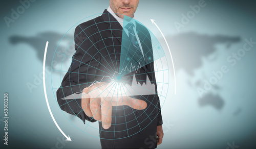 Businessman selecting a futuristic interface