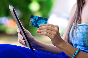 woman hand credit card and tablet