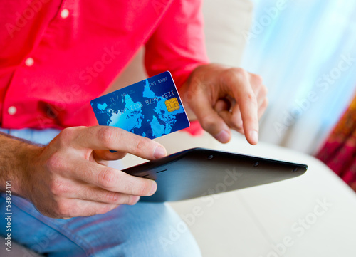 man hand credit card and tablet