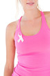 Woman wearing pink top and breast cancer ribbon