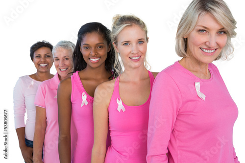 Group of diverse women wearing pink tops and ribbons for breast