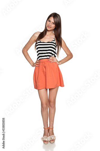 Smiling young woman standing in summer clothing