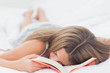 Young girl sleeping while holding a book