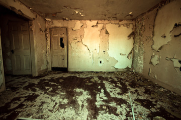 Frightening room in abandoned home with peeling paint