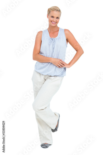 Woman smiling with hand on hip looking at camera