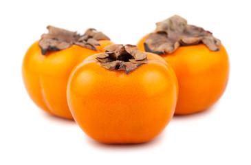 Three ripe persimmon fruits