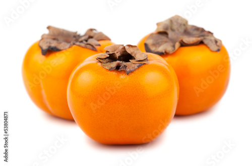Three ripe persimmon fruits