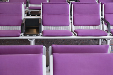 purple chair in the airport