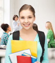 student girl with school bag and notebooks