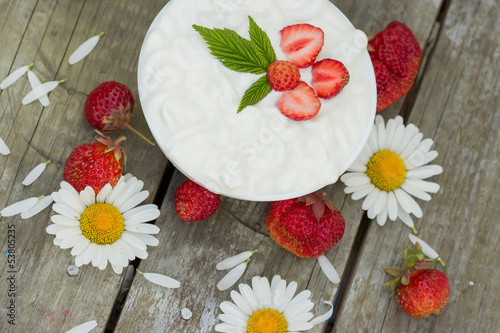 Top view of yogurt dessert with strawberries
