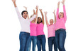 Cheering women wearing breast cancer ribbons