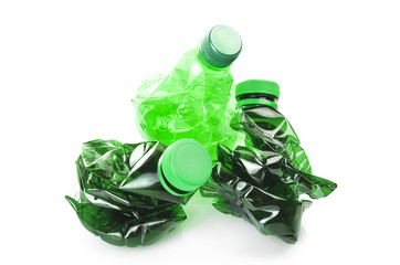 three bottles of green plastic on the white