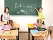 Children writing on blackboard.