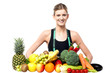 Slim fit girl with fresh fruits and vegetables
