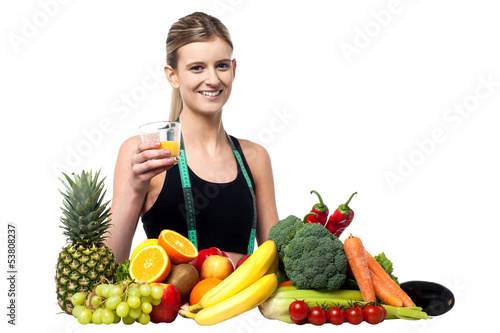 Pretty girl holding glass of fresh juice