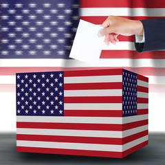 Hand holding ballot and box with the USA flag in the background
